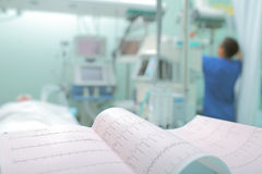 ECG at the background of medical staff working with the patient Stock Photo