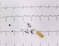 ECG and cigarette butt. The harm of smoking,. Photo Stock Photography