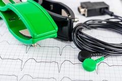 ECG electrodes on electrocardiogram Royalty Free Stock Photo