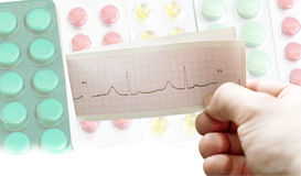 ECG in the hands of doctors against the background of different Royalty Free Stock Photos