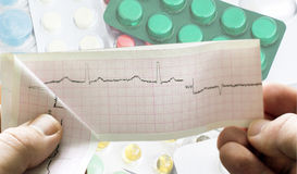 ECG in the hands of doctors against the background of different Royalty Free Stock Images