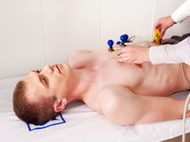 Ecg test of man. Ecg test of man at hospital royalty free stock photo