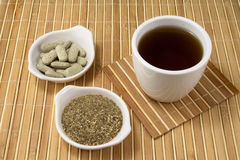 Echinacea products. Different echinacea plant products. Pills, tea and dried plant Stock Image