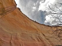 Echo Amphitheater Cliff. Echo Amphitheater is a colorful geological feature combined with unusual auditory properties located in Tierra Amarilla, New Mexico Rio stock image