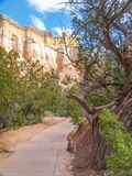Echo Amphitheater Cliffs in New Mexico. Echo Amphitheater is a colorful geological feature combined with unusual auditory properties located in Tierra Amarilla stock image