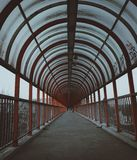 Echoing red arches. walkway with fading sunlight royalty free stock photography