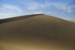 Echoing Sand dunes, China. Here we can see one of the typical sand dunes near Dunhuang, Prov. Gansu, China. These sand dunes are also called the Echoing Sand royalty free stock image
