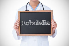 Echolalia against doctor showing little blackboard Royalty Free Stock Photo