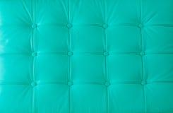 Echte leerstoffering op de moderne stoel Stock Afbeelding