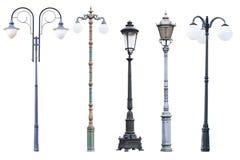 Echte uitstekende die straatlantaarnposten en lantaarns op witte bedelaars worden geïsoleerd Royalty-vrije Stock Fotografie