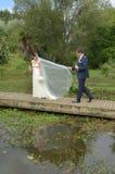 Echtgenoot en vrouw op hun huwelijksdag Royalty-vrije Stock Foto's