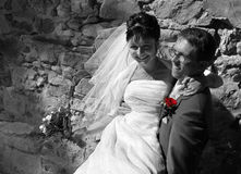 Echtgenoot en vrouw voor de muren Stock Afbeelding