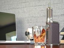 Ecig battery mod plus whiskey glass Royalty Free Stock Photo