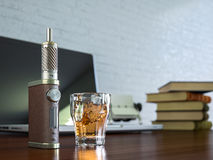 Ecig battery mod plus whiskey glass Stock Images