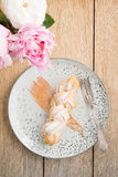 Eclair with buttercream filling Royalty Free Stock Image