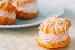 Eclair cake dessert. Sand dessert with a cream closeup stock photography