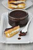 Eclair Chocolate. Chocolate eclair on a white plate stock images