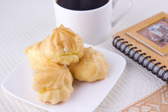 Eclair with Coffee Stock Photography