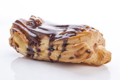 Eclair with cream in chocolate coating Royalty Free Stock Photos