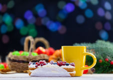Eclair and cup of coffee or tea Stock Photos