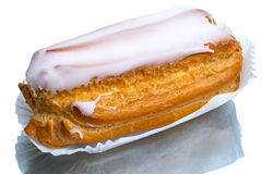 Eclair on a paper napkin Stock Photography