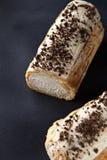 Eclair squisito del dessert alla panna Fotografia Stock