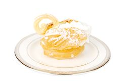 Eclair swan dessert on he plate. Stock Photography