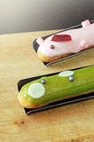 Eclair with topping Royalty Free Stock Image