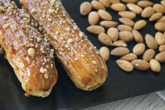Eclairs with almonds Stock Photography