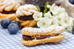 Eclairs with blueberry marmalade Stock Image