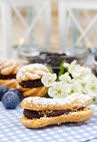Eclairs with blueberry marmalade Stock Photos
