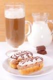 Eclairs with chocolate cream. Royalty Free Stock Photo