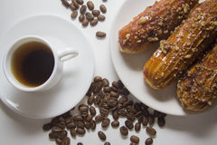 Eclairs and coffee Royalty Free Stock Photo