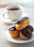 Eclairs with cream in chocolate coating Royalty Free Stock Image