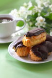 Eclairs with cream in chocolate coating Stock Image