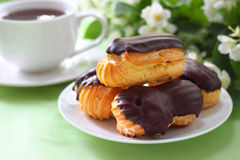 Eclairs with cream in chocolate coating Royalty Free Stock Photography