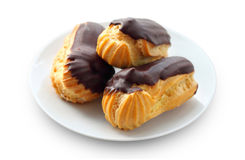 Eclairs with cream in chocolate coating Royalty Free Stock Images