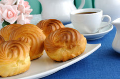 Eclairs with a cup of coffee Stock Images
