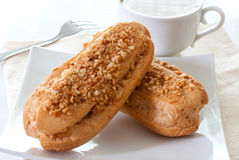Eclairs and cup of coffee Royalty Free Stock Photo