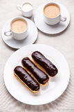 Eclairs de chocolate Imagem de Stock Royalty Free