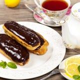 Eclairs de chocolate Fotos de Stock Royalty Free