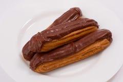 Eclairs de chocolate fotografia de stock