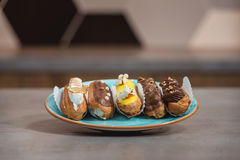 Eclairs with different ganache and icing with different toppings Stock Photography