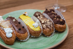 Eclairs with different ganache and icing with different toppings Royalty Free Stock Photo