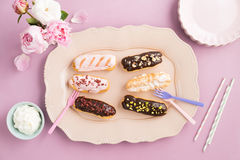 Eclairs with ganache and toppings Stock Image