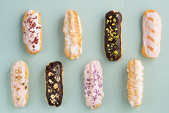 Eclairs with ganache and toppings Royalty Free Stock Photos