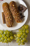 Eclairs and grapes Royalty Free Stock Photo