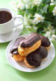 Eclairs In Chocolate Coating Stock Photos