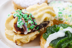 Eclairs with jam decorated with green sprinkles Royalty Free Stock Photos