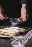 Eclairs in metal plate Royalty Free Stock Image